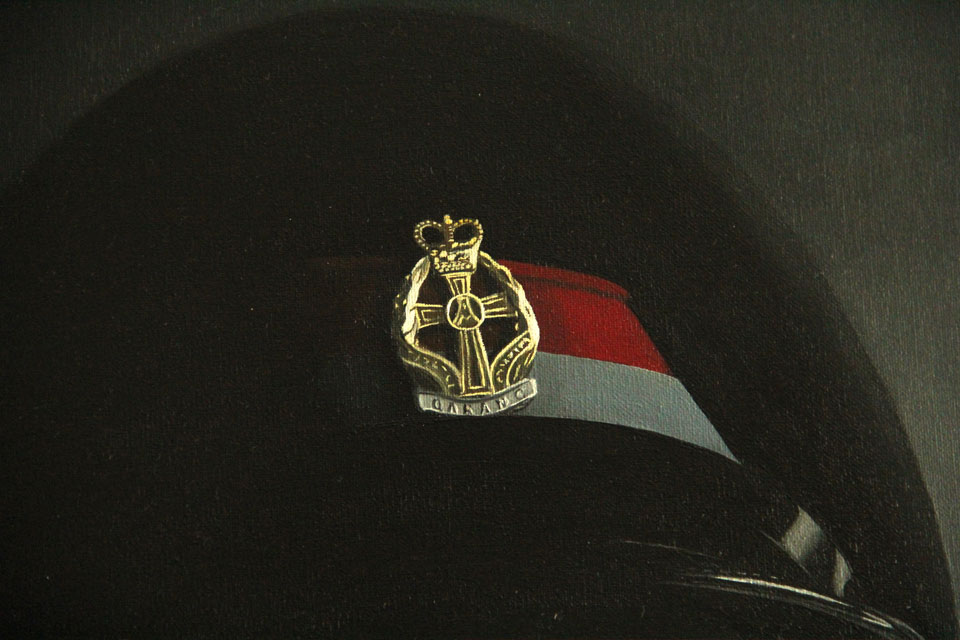 Painting of a hat featuring a Qaranc Military Badge
