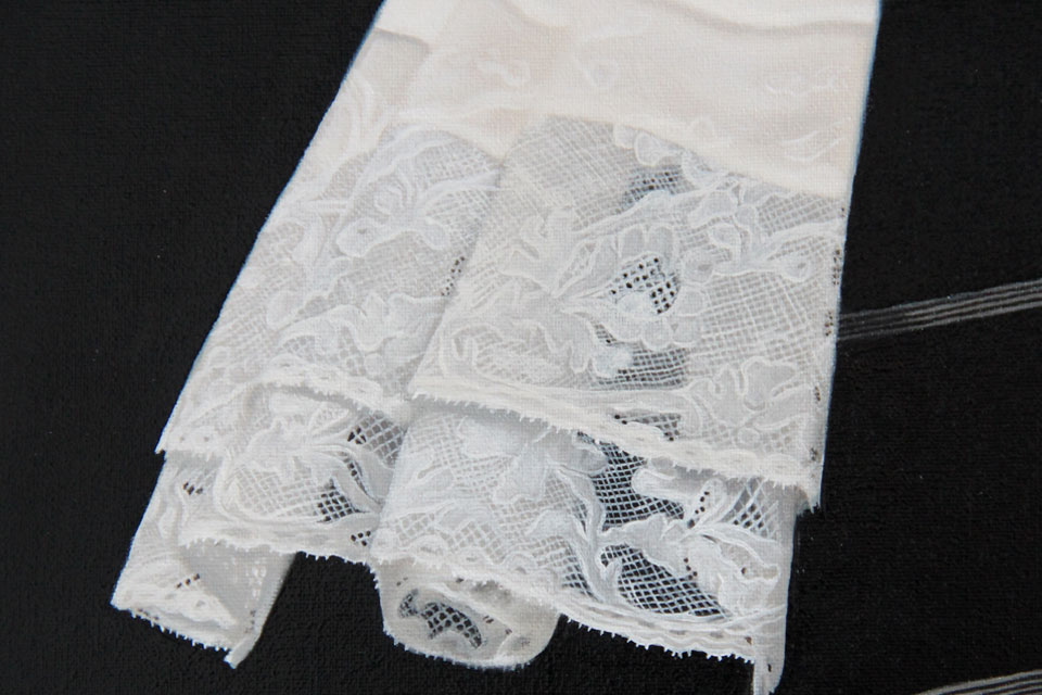 Fine detail painting of lace jabot