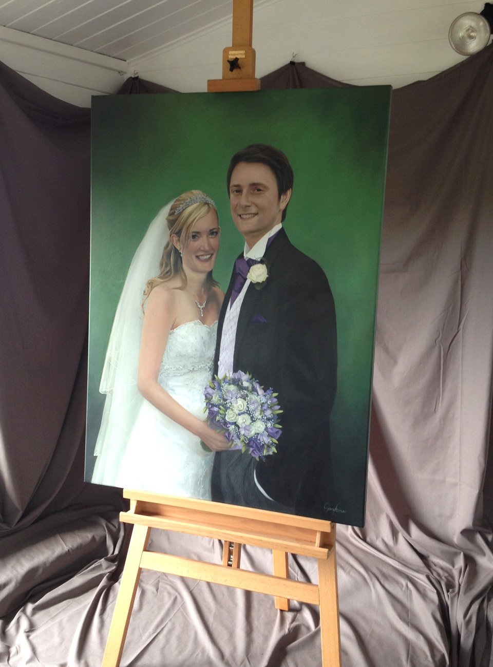 Finished wedding portrait painting on easel